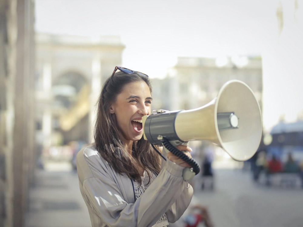 woman using a loud speaker